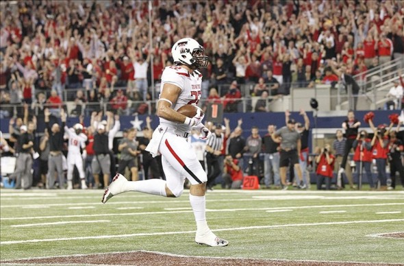 Nov 16, 2013; Arlington, TX, USA; Texas Tech Red Raiders tight end Jace Amaro (22) scores on a touchdown pass in the first quarter against the Baylor Bears at AT
