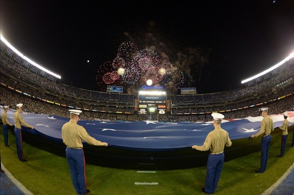 Dec 27, 2012; San Diego, CA, USA; General view of fireworks and a United States flag during the playing of the national anthem before the 2012 Holiday Bowl between the Baylor Bears and the UCLA Bruins at Qualcomm Stadium. Mandatory Credit: Kirby Lee/Image of Sport-USA TODAY Sports