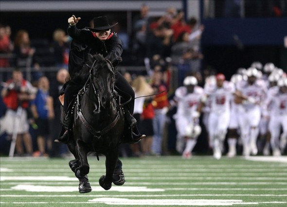 Nov 16, 2013; Arlington, TX, USA; Texas Tech Red Raiders the Masked Rider leads the team onto the field prior to the game against the Baylor Bears at AT