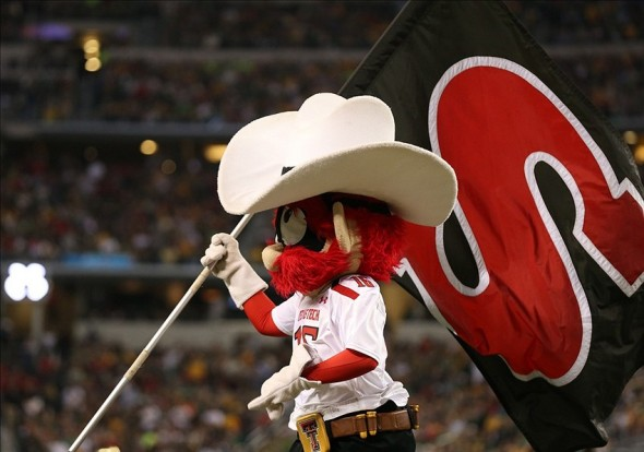 Nov 16, 2013; Arlington, TX, USA; Texas Tech Red Raiders mascot Raider Red carries a flag after a touchdown against the Baylor Bears at Cowboys Stadium. Mandatory Credit: Matthew Emmons-USA TODAY Sports