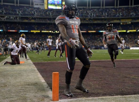 Dec 30, 2013; San Diego, CA, USA; Texas Tech Red Raiders receiver Jakeem Grant (2) scores on an 18-yard touchdown reception against the Arizona State Sun Devils during the 2013 Holiday Bowl at Qualcomm Stadium. Mandatory Credit: Kirby Lee-USA TODAY Sports