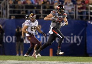 Dec 30, 2013; San Diego, CA, USA; Texas Tech Red Raiders tight end Jace Amaro (22) carries the ball against the Arizona State Sun Devils during the 2013 Holiday Bowl at Qualcomm Stadium. Mandatory Credit: Kirby Lee-USA TODAY Sports