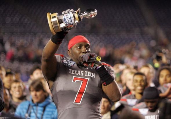 Dec 30, 2013; San Diego, CA, USA; Texas Tech Red Raiders defensive line backer Will Smith (7) wins the most valuable defensive player in the Holiday Bowl at Qualcomm Stadium. Mandatory Credit: Michael C. Johnson-USA TODAY Sports