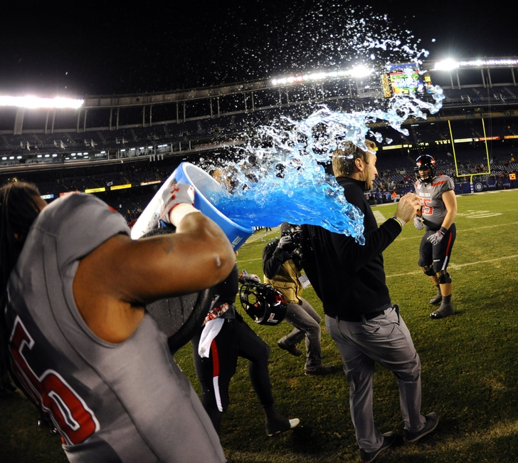 Dec 30, 2013; San Diego, CA, USA; Texas Tech Red Raiders head coach Kliff Kingsbury is dumped with Powerade in the closing seconds of the game against the Arizona State Sun Devils in the Holiday Bowl at Qualcomm Stadium. Texas Tech won 37-23. Mandatory Credit: Christopher Hanewinckel-USA TODAY Sports