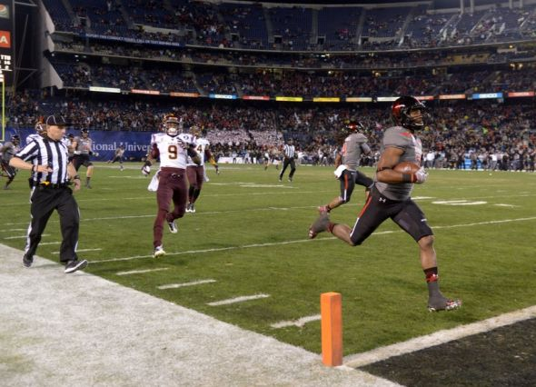 Dec 30, 2013; San Diego, CA, USA; Texas Tech Red Raiders receiver Reginald Davis (2) scores on a 90-yard kickoff return in the third quarter against the Arizona State Sun Devils during the 2013 Holiday Bowl at Qualcomm Stadium. Mandatory Credit: Kirby Lee-USA TODAY Sports