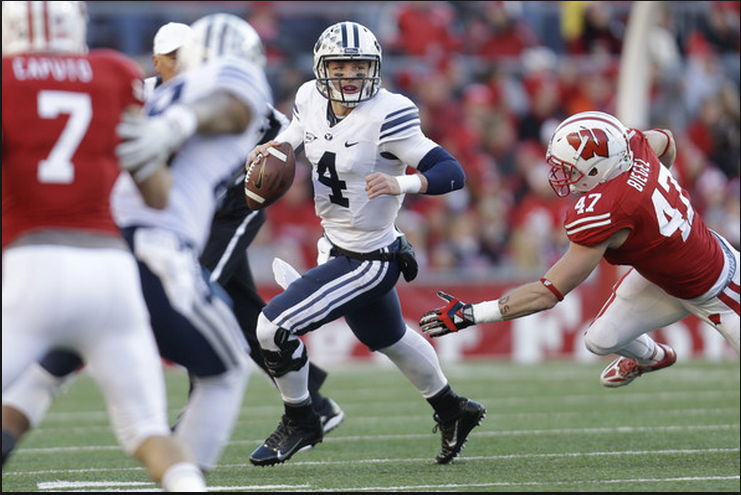 BYU Quarterback Taysom Hill scrambles against Wisconsin - Photo Credit: Mike McGinnis/Getty Images