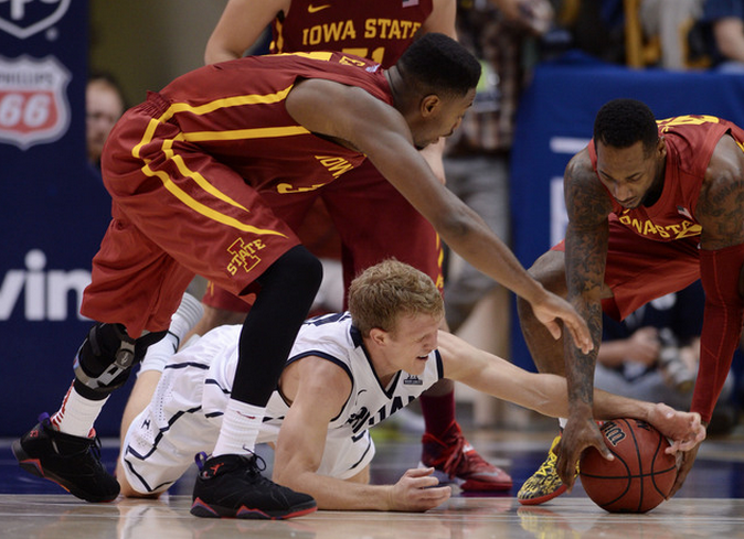 BYU Tyler Haws battles for a loose ball vs Iowa State. Photo Credit: Salt Lake Tribune