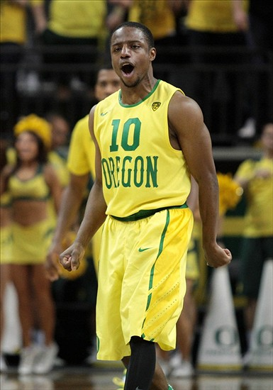 Mar 8, 2014; Eugene, OR, USA; Oregon Ducks guard Johnathan Loyd (10) reacts to a three point shot against the Arizona Wildcats at Matthew Knight Arena. Mandatory Credit: Scott Olmos-USA TODAY Sports
