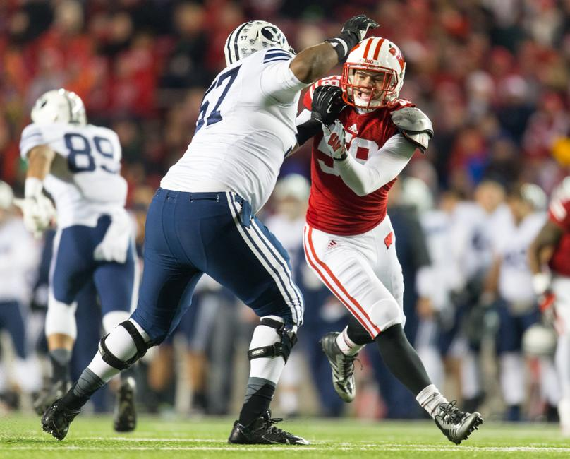 Nov 9, 2013; Madison, WI, USA; Wisconsin Badgers linebacker Joe Schobert (58) rushes as Brigham Young Cougars offensive lineman De