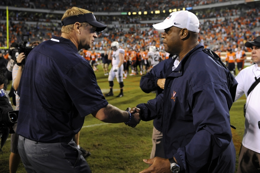 Aug 31, 2013; Charlottesville, VA, USA; Brigham Young Cougars head coach Bronco Mendenhall (left) and Virginia Cavaliers head coach Mike London (right) shake hands after a game at Scott Stadium. Mandatory Credit: Rafael Suanes-USA TODAY Sports