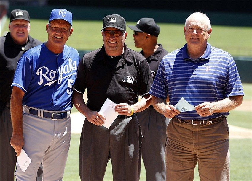 Jun 2, 2013; Arlington, TX, USA; (L to R) Kansas City Royals hitting coach George Brett (5), first base umpire Dale Scott and Texas Rangers ceo Nolan Ryan pose for a picture after delivering the starting line ups before the game at Rangers Ballpark in Arlington. Mandatory Credit: Tim Heitman-USA TODAY Sports
