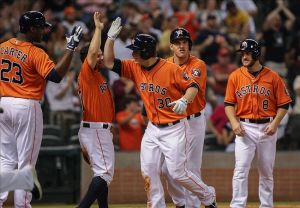 Sep 13, 2013; Houston, TX, USA; Houston Astros third baseman Matt Dominguez (30) celebrates with teammates after hitting a home run during the fifth inning against the Los Angeles Angels at Minute Maid Park. Mandatory Credit: Troy Taormina-USA TODAY Sports