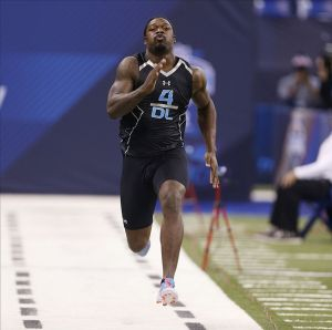 Feb 24, 2014; Indianapolis, IN, USA; South Carolina Gamecocks Jadeveon Clowney runs the 40 yard dash during the 2014 NFL Combines at Lucas Oil Stadium. Mandatory Credit: Brian Spurlock-USA TODAY Sports