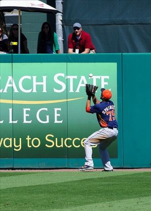 Mar 3, 2014; Jupiter, FL, USA; Houston Astros center fielder George Springer (79) fields a hit off the center field wall during a game against the Miami Marlins at Roger Dean Stadium. Mandatory Credit: Steve Mitchell-USA TODAY Sports
