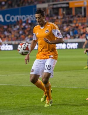 Mar 8, 2014; Houston, TX, USA; Houston Dynamo midfielder Tony Cascio (28) controls the ball during the match against the New England Revolution at BBVA Compass Stadium. The Dynamo shut out the Revolution 4-0. Mandatory Credit: Jerome Miron-USA TODAY Sports