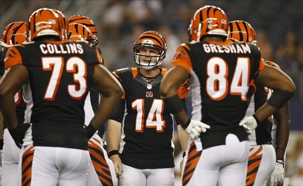 Aug 24, 2013; Arlington, TX, USA; Cincinnati Bengals quarterback Andy Dalton (14) in the huddle during a time out in the second quarter of the game against the Dallas Cowboys at AT