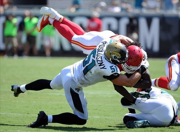 Sep 8, 2013; Jacksonville, FL, USA; Kansas City Chiefs running back Jamaal Charles (25) is tackled after a run by Jacksonville Jaguars linebacker Paul Posluszny (51) during the game at EverBank Field. Mandatory Credit: Melina Vastola-USA TODAY Sports