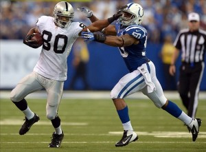 Sep 8, 2013; Indianapolis, IN, USA; Oakland Raiders receiver Rod Streater (80) is defended by Indianapolis Colts linebacker Jerrell Freeman (50) at Lucas Oil Stadium. The Colts defeated the Raiders 21-17. Mandatory Credit: Kirby Lee-USA TODAY Sports