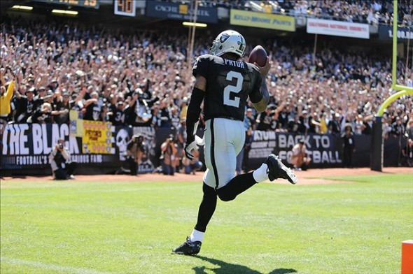 Sep 15, 2013; Oakland, CA, USA; Oakland Raiders quarterback Terrelle Pryor (2) runs into the end zone before being called back to the 11 yard line against the Jacksonville Jaguars during the first quarter at O.co Coliseum. Mandatory Credit: Kelley L Cox-USA TODAY Sports
