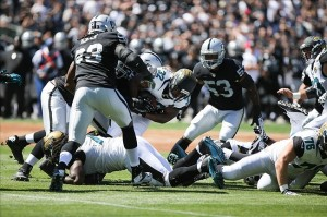 Sep 15, 2013; Oakland, CA, USA; Oakland Raiders tackle Jacksonville Jaguars running back Maurice Jones-Drew (32) during the first quarter at O.co Coliseum. Mandatory Credit: Kelley L Cox-USA TODAY Sports