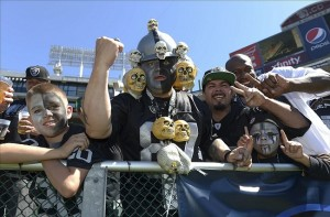 Sep 15, 2013; Oakland, CA, USA; Oakland Raiders fans pose during the game against the Jacksonville Jaguars at O.co Coliseum. The Raiders defeated the Jaguars 19-9. Mandatory Credit: Kirby Lee-USA TODAY Sports