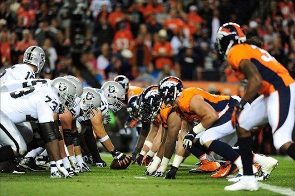 Sep 23, 2013; Denver, CO, USA; Members of the Oakland Raiders line up agains the Denver Broncos at the line of scrimmage during the second half at Sports Authority Field at Mile High. The Broncos won 37-21. Mandatory Credit: Chris Humphreys-USA TODAY Sports