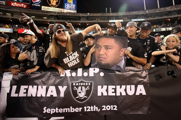 Oct 6, 2013; Oakland, CA, USA; Oakland Raiders fans hold a banner and picture of San Diego Chargers inside linebacker Manti Te