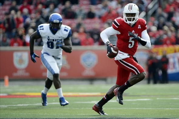Nov 23, 2013; Louisville, KY, USA; Louisville Cardinals quarterback Teddy Bridgewater (5) scrambles with the ball during the first quarter against the Memphis Tigers at Papa Johns Cardinal Stadium. Mandatory Credit: Jamie Rhodes-USA TODAY Sports