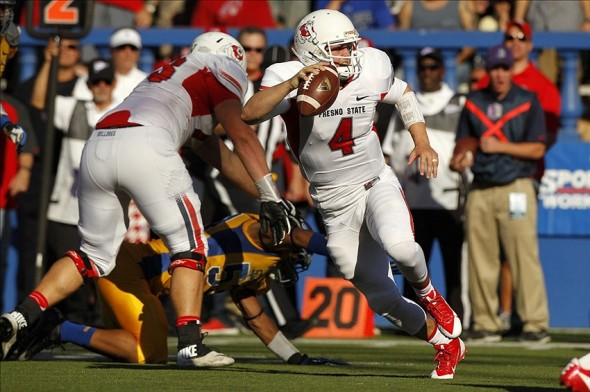 Nov 29, 2013; San Jose, CA, USA; Fresno State Bulldogs quarterback Derek Carr (4) runs the ball against the San Jose State Spartans in the second quarter at Spartan Stadium. The Spartans defeated the Bulldogs 62-52. Mandatory Credit: Cary Edmondson-USA TODAY Sports