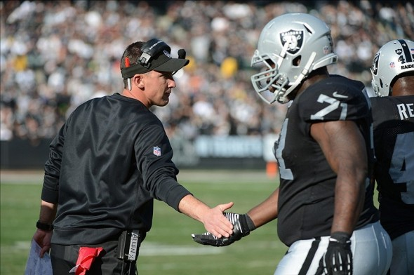 December 15, 2013; Oakland, CA, USA; Oakland Raiders head coach Dennis Allen high-fives offensive tackle Menelik Watson (71) against the Kansas City Chiefs during the first quarter at O.co Coliseum. Mandatory Credit: Kyle Terada-USA TODAY Sports