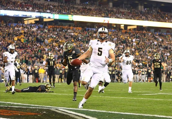 Jan 1, 2014; Glendale, AZ, USA; Central Florida Knights quarterback Blake Bortles runs into the end zone for a fourth quarter touchdown against the Baylor Bears during the Fiesta Bowl at University of Phoenix Stadium. Central Florida defeated Baylor 52-42. Mandatory Credit: Mark J. Rebilas-USA TODAY Sports