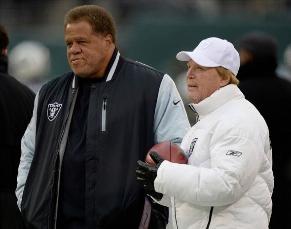 Dec 8, 2013; East Rutherford, NJ, USA; Oakland Raiders general manager Reggie McKenzie and owner Mark Davis on the field before the game against the New York Jets at MetLife Stadium. Mandatory Credit: Robert Deutsch-USA TODAY Sports