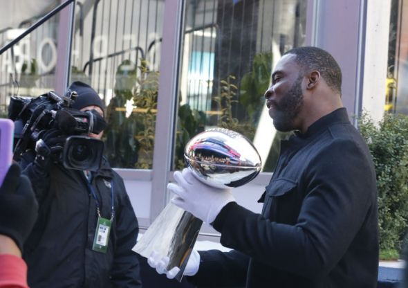 Jan 29, 2014; New York, NY, USA; New York Giants defensive lineman Justin Tuck holds the Vince Lombardi Trophy on Super Bowl Boulevard for Super Bowl XLVIII at the Prudential Center. Mandatory Credit: William Perlman/THE STAR-LEDGER via USA TODAY Sports