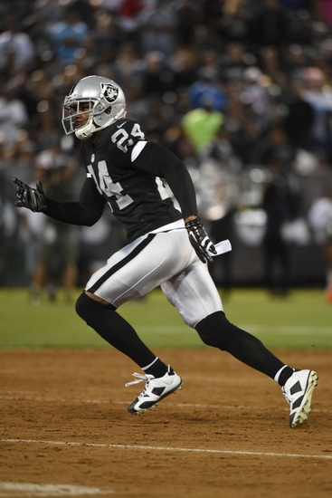 Charles woodson looks to make a defensive play against the Lions