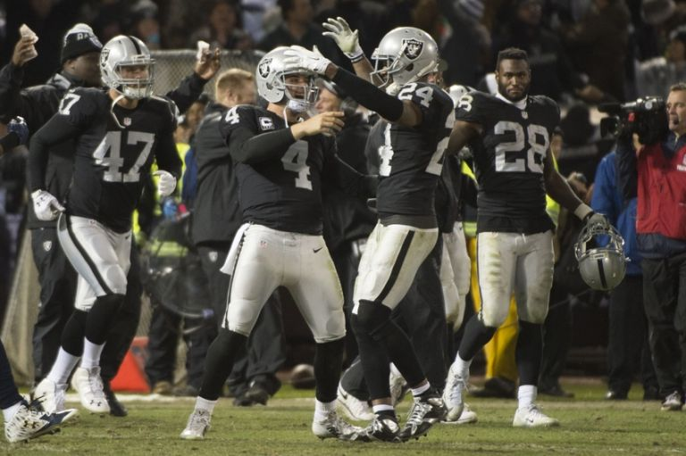 Derek-carr-charles-woodson-nfl-san-diego-chargers-oakland-raiders-1-768x0