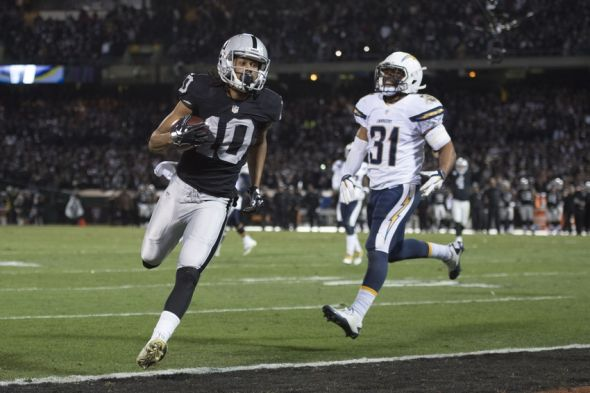 December 24, 2015; Oakland, CA, USA; Oakland Raiders wide receiver Seth Roberts (10) runs past San Diego Chargers cornerback Adrian Phillips (31) for a two-point conversion during the fourth quarter at O.co Coliseum. The Raiders defeated the Chargers 23-20. Mandatory Credit: Kyle Terada-USA TODAY Sports