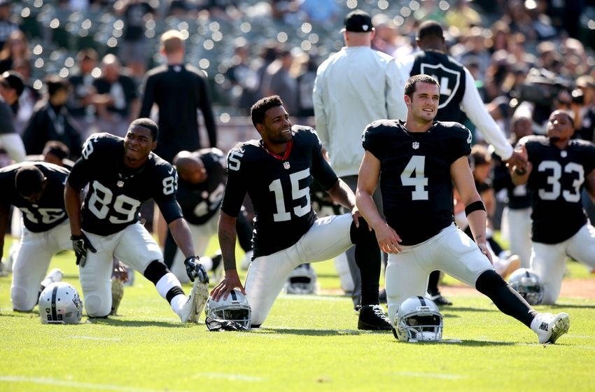 Aug 27, 2016; Oakland, CA, USA; Oakland Raiders quarterback Derek Carr (4), wide receiver Michael Crabtree (15) and wide receiver Amari Cooper (89) warm up before the start of the game against the Tennessee Titans at Oakland Alameda Coliseum. Mandatory Credit: Cary Edmondson-USA TODAY Sports