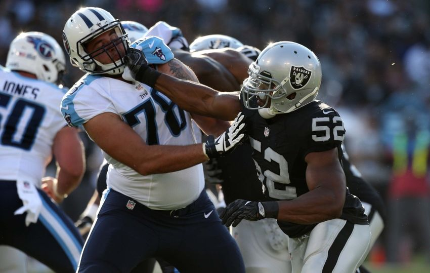 Aug 27, 2016; Oakland, CA, USA; Oakland Raiders defensive end Khalil Mack (52) attempts to rush past Tennessee Titans offensive tackle Jack Conklin (78) in the second quarter at Oakland Alameda Coliseum. Mandatory Credit: Cary Edmondson-USA TODAY Sports