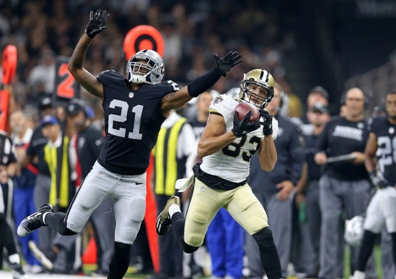 Sep 11, 2016; New Orleans, LA, USA; New Orleans Saints wide receiver Willie Snead (83) makes a catch while defended by Oakland Raiders defensive back Sean Smith (21) in the second quarter at the Mercedes-Benz Superdome. Mandatory Credit: Chuck Cook-USA TODAY Sports
