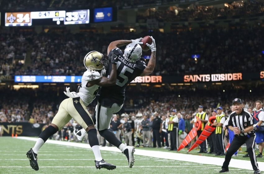 Sep 11, 2016; New Orleans, LA, USA; Oakland Raiders wide receiver Michael Crabtree (15) makes a catch for a two-point conversion while defended by New Orleans Saints cornerback Ken Crawley (46) late in the fourth quarter at the Mercedes-Benz Superdome. The Raiders won 35-34. Mandatory Credit: Chuck Cook-USA TODAY Sports