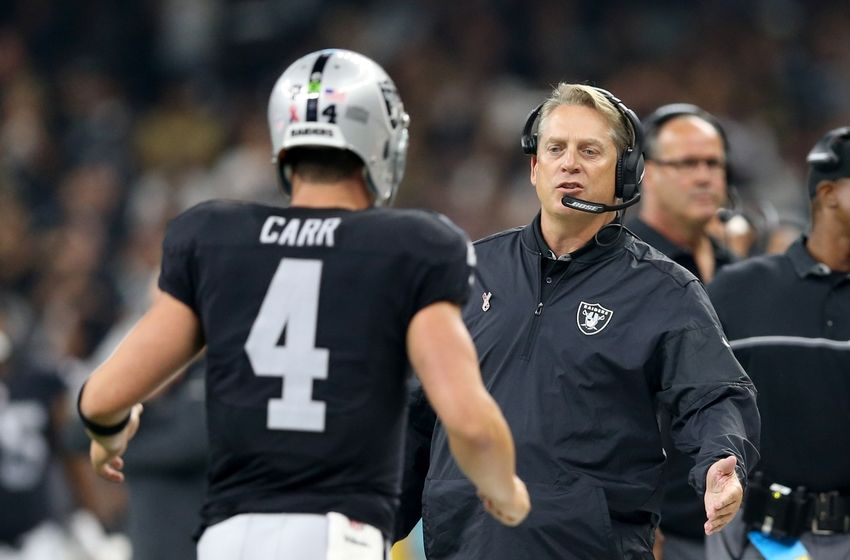 Sep 11, 2016; New Orleans, LA, USA; Oakland Raiders head coach Jack Del Rio talks to quarterback Derek Carr (4) in the second quarter of their game against the New Orleans Saints at the Mercedes-Benz Superdome. Mandatory Credit: Chuck Cook-USA TODAY Sports