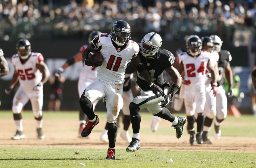 Sep 18, 2016; Oakland, CA, USA; Atlanta Falcons wide receiver Julio Jones (11) runs with the ball after making a catch against the Oakland Raiders in the fourth quarter at Oakland-Alameda County Coliseum. The Falcons defeated the Raiders 35-28. Mandatory Credit: Cary Edmondson-USA TODAY Sports