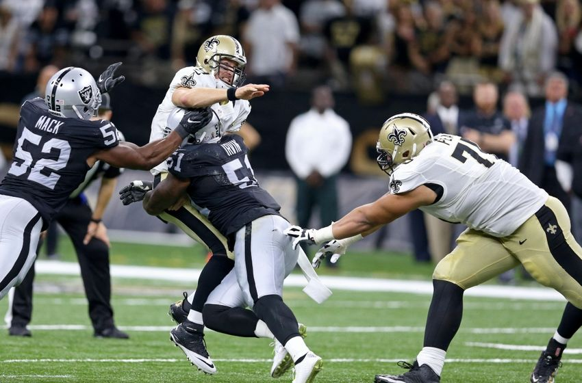 Sep 11, 2016; New Orleans, LA, USA; New Orleans Saints quarterback Drew Brees (9) is hit by Oakland Raiders linebacker Bruce Irvin (51) while Saints offensive guard Andrus Peat (75) tries to block in the second half at the Mercedes-Benz Superdome. Raiders won, 35-34. Mandatory Credit: Chuck Cook-USA TODAY Sports