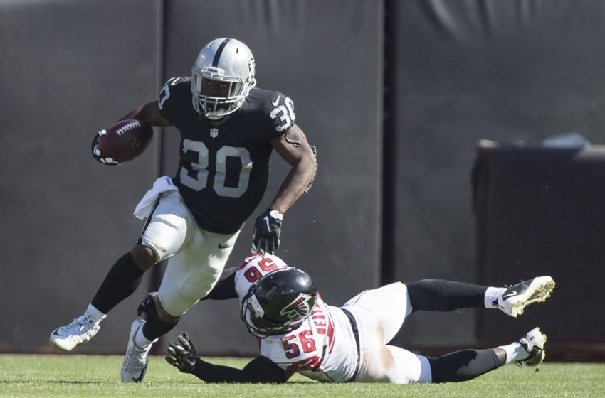 September 18, 2016; Oakland, CA, USA; Oakland Raiders running back Jalen Richard (30) runs with the football past Atlanta Falcons linebacker Sean Weatherspoon (56) during the third quarter at Oakland Coliseum. The Falcons defeated the Raiders 35-28. Mandatory Credit: Kyle Terada-USA TODAY Sports