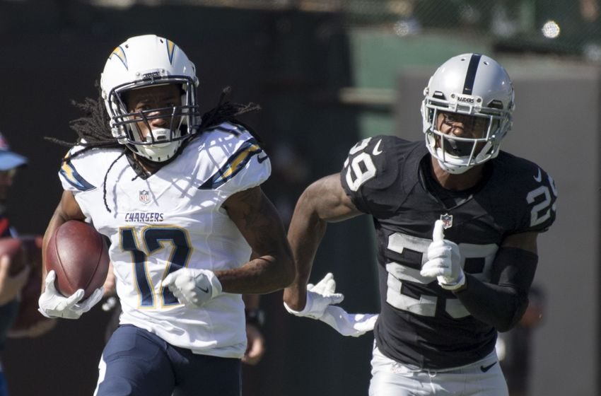 October 9, 2016; Oakland, CA, USA; San Diego Chargers wide receiver Travis Benjamin (12) runs past Oakland Raiders cornerback David Amerson (29) during the second quarter at Oakland Coliseum. Mandatory Credit: Kyle Terada-USA TODAY Sports