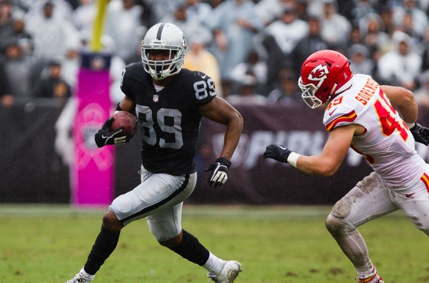 Oct 16, 2016; Oakland, CA, USA; Oakland Raiders wide receiver Amari Cooper (89) carries the ball in front of Kansas City Chiefs defensive back Daniel Sorensen (49) during the second quarter at Oakland Coliseum. Mandatory Credit: Kelley L Cox-USA TODAY Sports