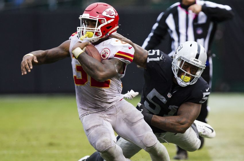 Oct 16, 2016; Oakland, CA, USA; Kansas City Chiefs running back Spencer Ware (32) escapes Oakland Raiders outside linebacker Bruce Irvin (51) during the third quarter at Oakland Coliseum. The Kansas City Chiefs defeated the Oakland Raiders 26-10. Mandatory Credit: Kelley L Cox-USA TODAY Sports