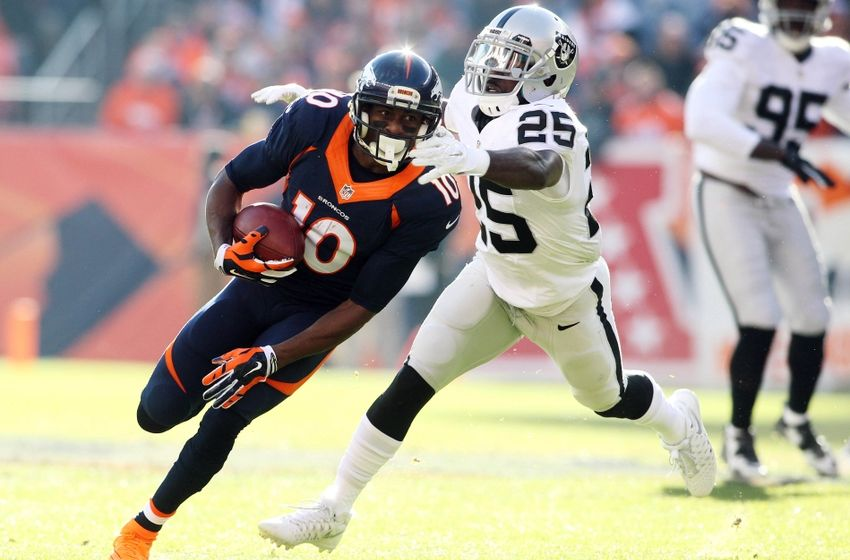 Dec 13, 2015; Denver, CO, USA; Denver Broncos wide receiver Emmanuel Sanders (10) runs with the ball against Oakland Raiders cornerback D.J. Hayden (25) during the first half at Sports Authority Field at Mile High. Mandatory Credit: Chris Humphreys-USA TODAY Sports