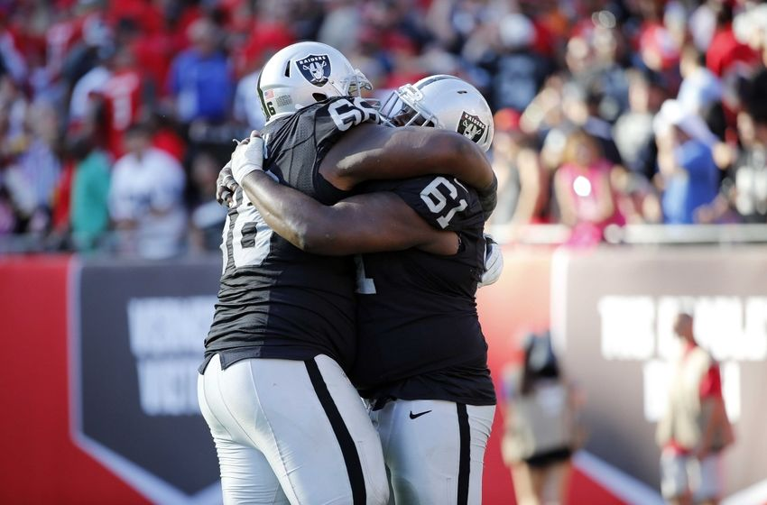 Oct 30, 2016; Tampa, FL, USA; Oakland Raiders guard Gabe Jackson (66) and center Rodney Hudson (61) hug after they beat the Tampa Bay Buccaneers in overtime during the second half at Raymond James Stadium. Oakland Raiders defeated the Tampa Bay Buccaneers 30-24 in overtime. Mandatory Credit: Kim Klement-USA TODAY Sports