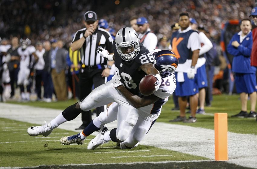 Nov 6, 2016; Oakland, CA, USA; Oakland Raiders running back Latavius Murray (28) is stopped short of the end zone by Denver Broncos safety Darian Stewart (26) in the second quarter at Oakland Coliseum. Mandatory Credit: Cary Edmondson-USA TODAY Sports